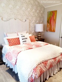 Coral Master Bedroom idea from the parade of homes! Sucha cute idea for a pop of color against a fairly neutral color scheme. Featured on Remodelaholic.com