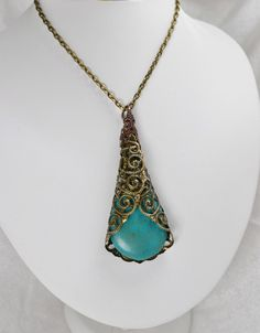 Peacock Lace Antique Bronze Filigree Wrap Turqouise Dyed Howlite Pendant Neclace. $15.00, via Etsy.