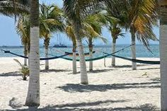 Isla Mujeres in front of Cancun. Isla Mujeres is the perfect place fo those looking for relaxation, fun and passion. Short Vacation, Vacation Places, Vacation Destinations, Vacation Spots, Places To Travel, Sand And Water, Water Me, Great Places, Places To See