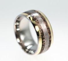 Dinosaur Ring / Gibeon Meteorite Ring / 14K Gold / Titanium Wedding Band - Meteor Ring Signature Series. $896.00, via Etsy.