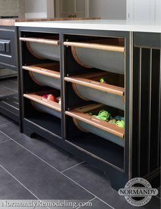 Wire mesh drawers allow for easy access to fresh fruits and veggies while adding interest to a space.