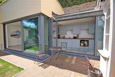 Open the bi-fold doors of the kitchen and dining area into the garden for Al-fresco dining at 42 Above Town, Dartmouth