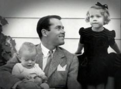 Henry Fonda holding Peter Fonda, and his daughter Jane Fonda is at the right. This was taken in 1940