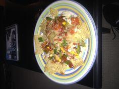 Healthy chicken nachos  Shredded chicken Corn, capsicum, tomato and red onion salsa Cheese  = delicious!!