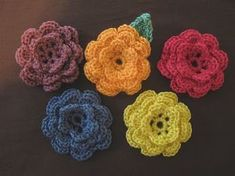 How to crochet flowers for hats, etc. Includes pattern and how-to YouTube videos. #crochetflowers