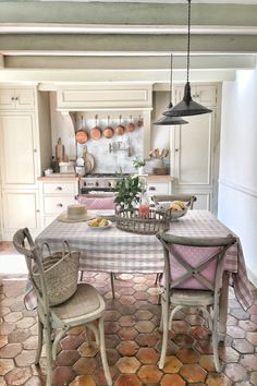 Terracotta hexagon tiles in a kitchen in France. French farmhouse design inspiration, house tour, French homewares and market baskets from Vivi et Margot. Photos by Charlotte Reiss French Country Interiors, French Country Rug, Country Interior Design, French Farmhouse Decor, Country Kitchen Designs, French Country Kitchens, French Country Living Room, Modern Farmhouse Kitchens, Farmhouse Style Kitchen