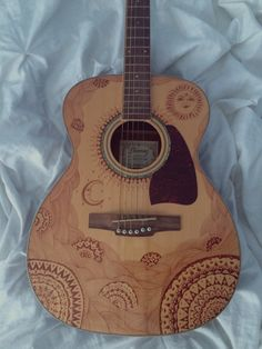 I decorated this guitar with brown sharpie for a friend! Considering doing this for more people :)
