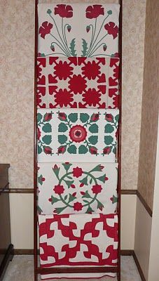 Christmas quilt ladder, a beautiful array of antique quilts