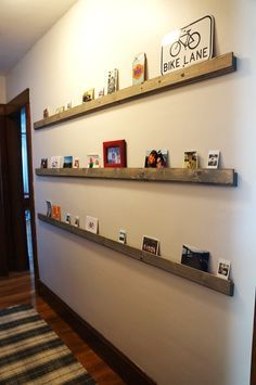 Fun Low Profile hallway shelves for cards, photos, Etc. I can collect stuff for the whole year then make a memory box on New Year's Eve.