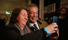Nigel Farage, the Ukip leader, has a selfie taken with a woman at the Thanet beer festival in Margate