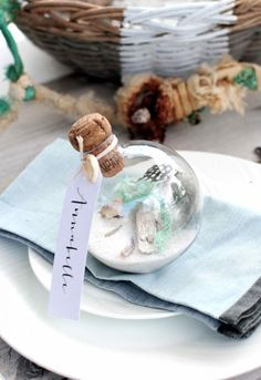 Fill Christmas baubles with breach treasures to make coastal-style place settings