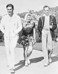 Errol Flynn strolling with his mom Marelle and dad Theodore