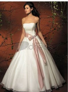 A ball gown wedding dress features a tight bodice, a loose or fitted waist and flared hips that fall into a floor length skirt. Wedding and ball gowns come in a variety of styles but are always beautiful, glamorous, and Wedding Dress Sash, Wedding Dress Sizes, Colored Wedding Dresses, Wedding Attire, Bridal Dresses, Modest Wedding, Ivory Wedding, Tulle Wedding, Wedding Gowns