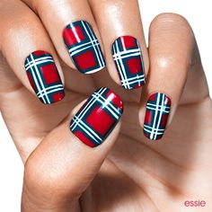 Your marching orders: strut your stuff in this adorable plaid nail art design.