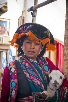 Quechua girl in the Andes near Pisac.  She earns money by taking photos with tourists...by Oleg Gutsol...