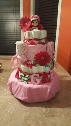 Okay,  I added a tier to my strawberry shortcake diaper cake. I think it's a slight improvement,  plus more diapers for the mommy!