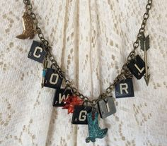 Vintage Scrabble Up Cycled Charm Cowgirl Necklace by RanchoRetroVintage on Etsy https://www.etsy.com/listing/489246575/vintage-scrabble-up-cycled-charm-cowgirl