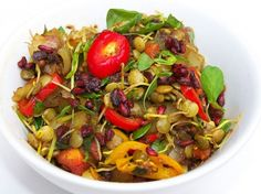 Edible Aria shares a traditional, healing dish of sprouted lentils in a spicy, savory tomato sauce with toasted whole spices, onions, peppers, pea shoots and wild pomegranate seeds. Yum!
