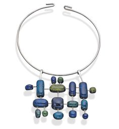 """Elsa Freund crafted """"Space Pendant with Circlet"""" in the early 1960s out of silver wire and colored glass fused on dark-blue-glazed terracotta. She said, """"As I see it,"""" said painter, weaver and jeweler Elsa Freund, """"there are two ways to approach jewelry making. One is to give a precious stone a proper setting. The other is to give something of no particular value a worth by making it a thing of beauty. Of the two methods, I prefer the latter."""""""