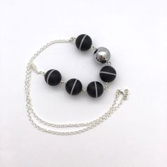 A modern take on a black and white necklace.  Monochrome necklace / minimal necklace / black by LimeJewellery