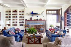 The layering of pattern on pattern in this Lake Michigan house starts with the living room fireplace, decorated with kaleidoscopic Moroccan tile from Urban Archaeology. Designer Martin Horner of Soucie Horner upholstered the sofas in not one, but two fabrics — Dedar's Sottosopra on the frame and Bergamo's Ucria on the cushions. Throw pillows made out of vintage textiles by Lynda O'Connor add more color. C&C Milano's Pienza Rafano covers the club chairs. Rug by Oscar Isberian.