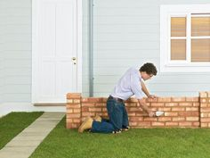 Plan on doing this project over a couple of weekends. Lay the footings for the wall and allow it to dry for a few days before starting to build the wall. In this technique, build up the ends of the wall, like a flight of steps, and fill in the central area. Getting the first course of brickwork in the right position is essential.