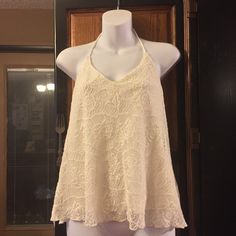 Cream Lace Halter with cream liner top 48% cotton, 38% nylon, 19%rayon . Ties around neck . Underarm to bottom  14 inches . Mudd Tops