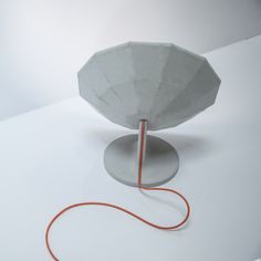 """French designer Matali Crasset has created a collection of concrete furniture, including a lamp shaped like an interwar military listening device.The lamp references concrete acoustic mirrors, also known as """"listening ears"""", which were developed in Britain between the wars to concentrate sound waves and detect airborne invasions."""