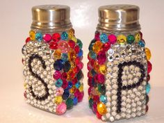 Salt and Peppa shakers! No color gems though. Just straight silver with black letters.