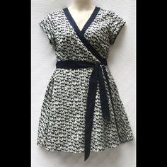 "New Eshakti Fit & Flare Wrap Dress XL 18 New Eshakti horse print fit & flare cotton wrap dress. Size XL 18 Measured flat: Underarm to underarm: 41"" Waist: 36-38"" Length: 37"" Eshakti size chart for bust: 45"" True wrap style, contrast trim in navy, side seam pockets, flared A line skirt. Cotton woven poplin, pre-shrunk-shrunk & bio-polished. Machine wash. Eshakti Dresses"
