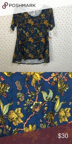 LuLaRoe Perfect T Legging Material L NWT Gorgeous legging material Perfect T swing shirt from LuLaRoe! Blue background with yellow flowers and vines. Size large, new with tags. LuLaRoe Tops Tees - Short Sleeve