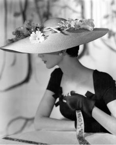 Dovima wearing a hat by Hattie Carnegie photographed by Horst P. Horst, Vogue, 1954