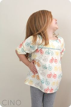 Adorable! ( the fabric, pattern & little girl!) Bicycle Class Picnic blouse - free tutorial @ craftinessisnotoptional