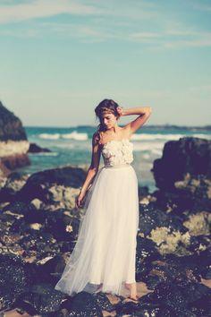 braided hair + flower & that dress. bride. wedding. beach.