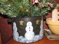 Paint snowmen on that old pot and put a small Christmas tree in for cute decoration