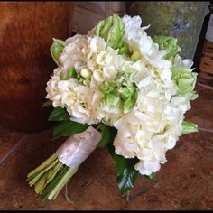 St. Patrick's Day bouquet with hydrangea and green parrot tulips by Preston Flowers.  In Cary North Carolina . Www.prestonflowers.com