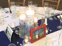 We had fun setting these items.   STTK provided navy runners, mirror tile and a set of 3 sized cylinders.  plus all the mini hurricane candles you see.