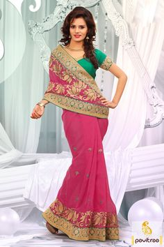 Embellished with lace patti, resham and embroidery works. The net and dhupion made pink green designer party wear saree is very attractive in overall looks.