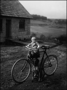 Available for sale from ClampArt, August Sander, Forester's Child, Westerwald [Farm Child on Bicycle] Gelatin silver print, 10 × 7 in August Sander, Vintage Children, Vintage Bicycles, Vintage Photographs, Vintage Photos, Diane Arbus, Retro Kids, Getty Museum, Black White