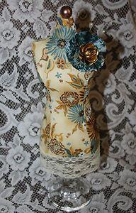 http://www.ebay.com/itm/LaDeDa4U-Dress-Form-Pin-Cushion-Table-Top-Decor-/171141919401?pt=LH_DefaultDomain_0&hash=item27d8da72a9