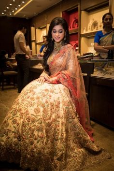 Bridal Details - Bride in a Beige and Orange Lehenga with Gold Jewelry | WedMeGood #wedmegood #indianbride #indianwedding #lehenga #bridallehenga #manubhaijewelry