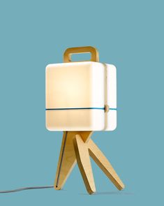 A soft light emerges from the translucent shells of this simple table lamp by Jos Blom