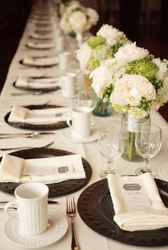 Floral Arrangements ~ green and white, ribbon around stems. The centre piece you choose is one of the things the guests will see the longest. Make sure it is one to remember.