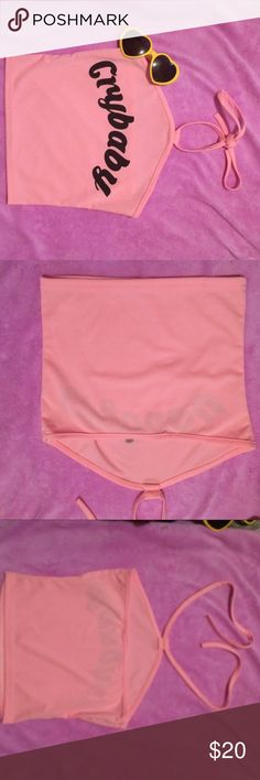 Cry baby halter crop  NWOT! Pink cry baby halter crop. Size small. Unbranded. Tags; Melanie Martinez crybaby halter summer unif dollskill aa nastygal hot.  ASK HOW TO SAVE EVEN MORE ON BUNDLES AND SHIPPING UNIF Tops Crop Tops