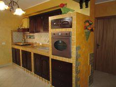 cucina in muratura - realizzazione pensili e sportelli in legno massello