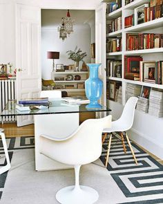 Does it get any better than this? I love any room with shelves of books, but using the dining room as a combination library is my kind of design. Want the rug! LJH