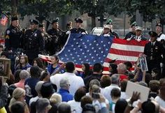 Nation pauses on 9/11 to pay tribute to victims - Life in lower Manhattan resembled any ordinary day on Wednesday as workers rushed to their jobs in the muggy heat, but time stood still at the World Trade Center site while families wept for loved ones who perished in the terror attacks 12 years ago. Read more: http://www.norwichbulletin.com/carousel/x1868836852/9-11-anniversary-marked-with-somber-tributes #September11 #NeverForget