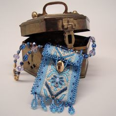Unique Hand Beaded Amulet Bag Pendant with Shades of Blue Necklace. $25.00, via Etsy.