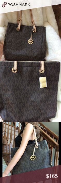 Michael Kors East West Shoulder Bag NWT Michael Kors Brown and Tan East West Shoulder Bag Tote. It has the gold MK Signature Emblem on front. Key chain inside with pockets for those need to get to quick items. Michael Kors Bags Shoulder Bags