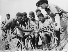 New Guinea. Members of a Papuan Infantry Unit prior to a forward area patrol. Sergeant F. Wust of Eumundi, Qld, checks his patrol's weapons. West Papua, Ww2 History, Fuzzy Wuzzy, Anzac Day, Extraordinary People, Lest We Forget, Papua New Guinea, World War Two, World Cultures